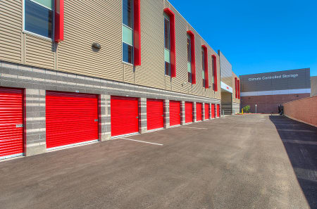 Exterior view of drive-up access storage units at StorQuest Self Storage