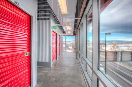 Interior storage unit hallways at StorQuest Self Storage with a view of Denver