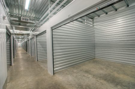 Well-lit interior hallway and partial view of storage unit at StorQuest Express - Self Service Storage in Woodland