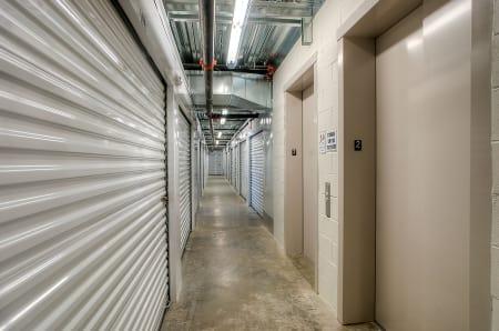 Well lit hallways at StorQuest Self Storage in Anaheim, CA