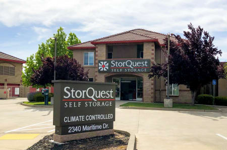 Front entrance and sign at StorQuest Self Storage in Elk Grove, CA