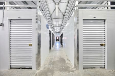 Interior storage unit hallway at StorQuest Express - Self Service Storage in Deltona, FL