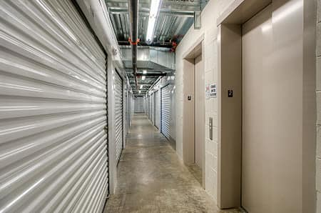 Hallway of storage units at StorQuest Self Storage in Paramount, California