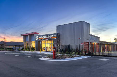 Store front twilight at StorQuest Express - Self Service Storage in Deltona, FL