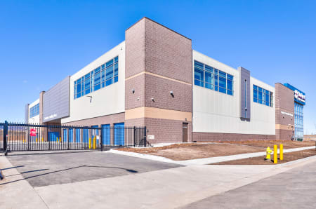 Exterior view and gated entrance at StorQuest Self Storage in Arvada, CO