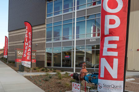 Open signs in front of StorQuest Self Storage in Redwood City, California