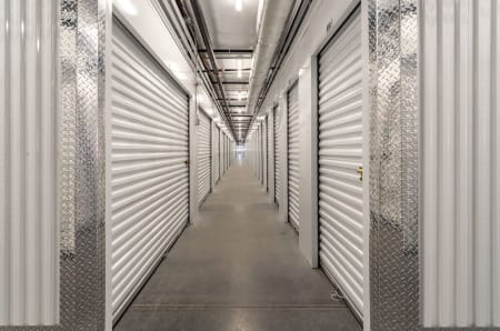 Hallway of interior storage units at StorQuest Express - Self Service Storage in Palm Coast, Florida