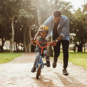 Learning to ride a bike at Lexington Park Apartments in Smyrna, Georgia