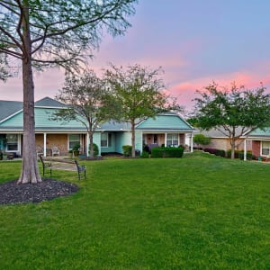 Green lawn outside of Sunstone Village at sunset in Denton, Texas