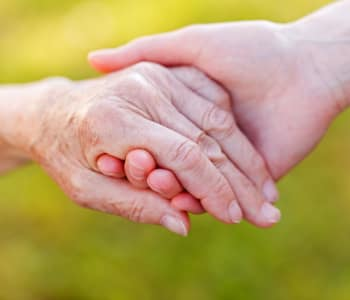 Holding hands at Arbors Memory Care in Sparks, NV