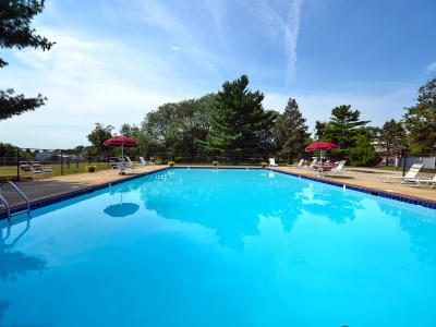 Swimming pool and sun deck area at William Penn Village Apartment Homes in New Castle, Delaware