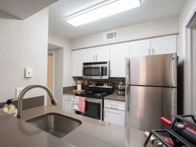 An apartment kitchen at Fairways at Feather Sound in Clearwater, FL