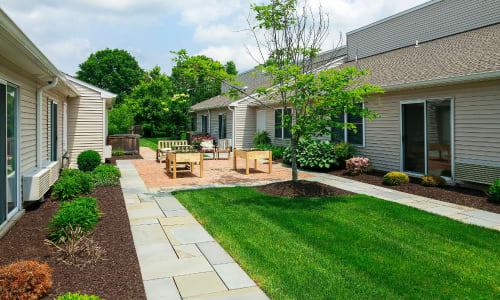 Spacious green walkways at Traditions of Lansdale in Lansdale, Pennsylvania
