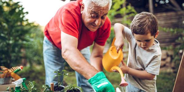 Man and grandson gardening at Autumn Grove Cottage at Blanco in San Antonio, Texas