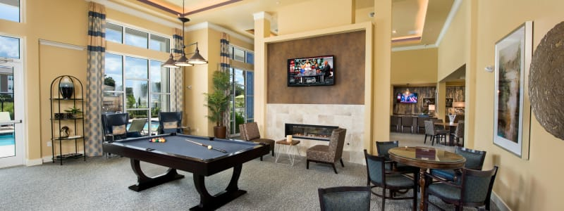 Clubhouse with a billiards table at Integra Lakes in Casselberry, Florida