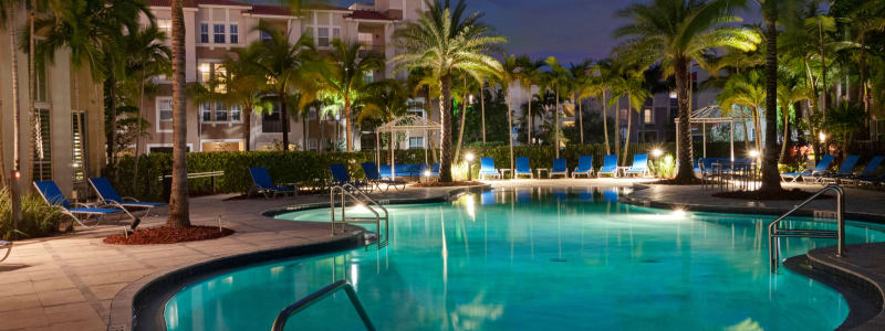 Poolside seating at City Center on 7th Apartment Homes in Pembroke Pines, Florida