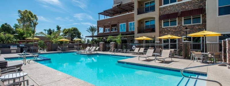 Resort-style swimming pool at Luxe Scottsdale Apartments in Scottsdale, Arizona