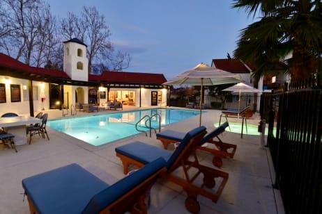 Woman lounging in the pool by Berkshire Laurel Creek, Fairfield, California