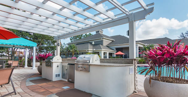 Outdoor BBQ grill area at Landings at Four Corners in Davenport, Florida