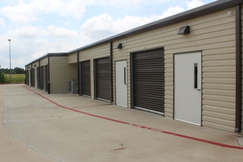 A row of storage units at Town Creek Storage in Montgomery, Texas