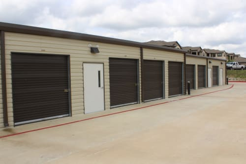 A row of outdoor storage units at Town Creek Storage in Montgomery, Texas