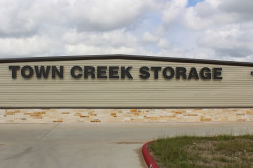 A large sign of Town Creek Storage in Montgomery, Texas