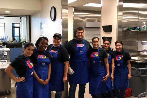 Rockstar Capital staff in the kitchen volunteering