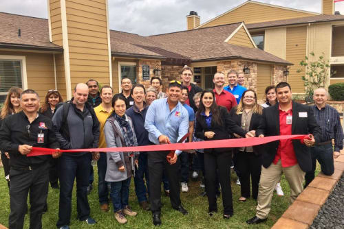 Palms at Chimney Rock Apartments ribbon cutting ceremony