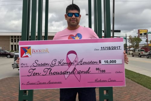 Large check for Susan G Komen Foundation from Westport Apartments in Angleton, Texas