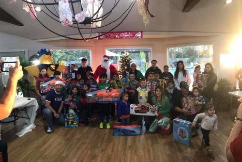Christmas presents for families in need near Westport Apartments in Angleton, Texas