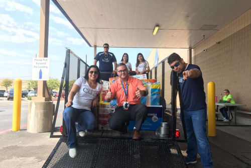 Westport Apartments staff delivering goods for charity in Angleton, Texas