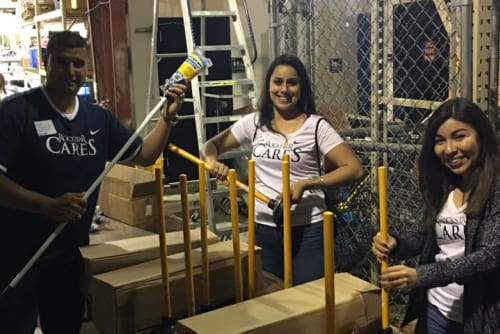 Westport Apartments staff putting together plungers in Angleton, Texas