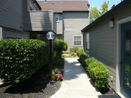 Landscaped bushes around Courtside Village Apartments in Woodland, CA