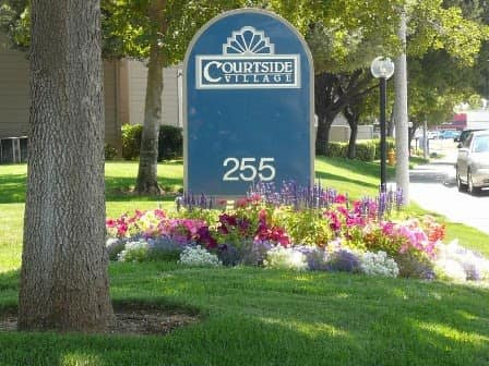 Front entrance to Courtside Village Apartments in Woodland, CA