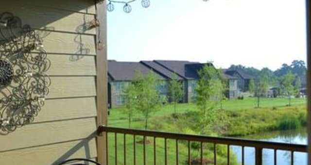 Balcony view of pond at The Grove at Stone Park in Pike Road, Alabama