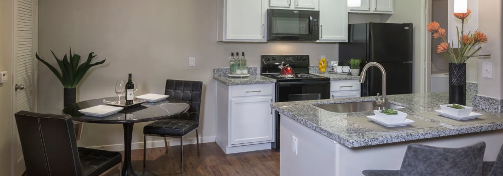A kitchen with plenty of counter space at Sommerall Station Apartments in Houston, Texas