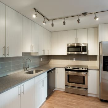 Kitchen with stainless steel appliances at Royal View Apartments in Calgary