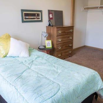 A bedroom at Campus View & Kirkwood Court in Cedar Rapids, Iowa