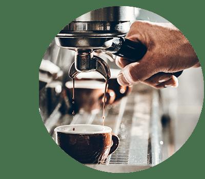 Barista making coffee at cafe near The Barrett in Marietta, Georgia