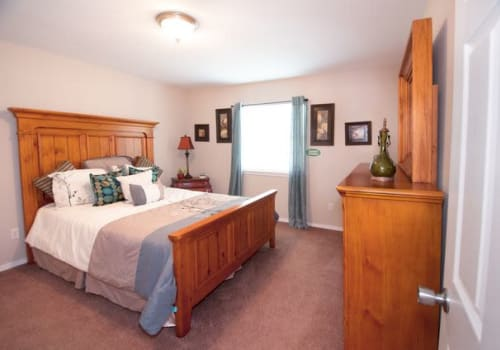 Comfortable bedroom at Summerfield Apartment Homes in Harvey, Louisiana