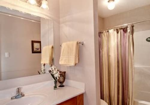 Bathroom and vanity space at Summerfield Apartment Homes in Harvey, Louisiana