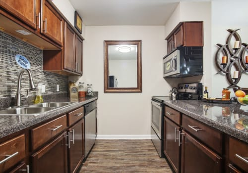 Kitchen with back splashes at Emerald Pointe Apartment Homes in Harvey, Louisiana