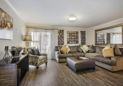 Upgraded living room at Emerald Pointe Apartment Homes in Harvey, Louisiana
