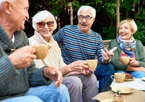 Residents sitting outside eating at Quail Park at Morrison Ranch in Gilbert, Arizona
