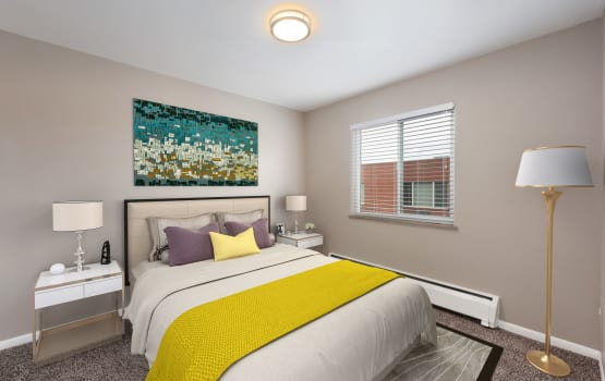 Beautiful bedroom at Asbury Plaza in Denver, Colorado