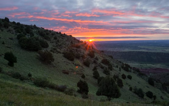 Sunset on a beautiful hillside near Eagle Crest Apartments in Lakewood, Colorado