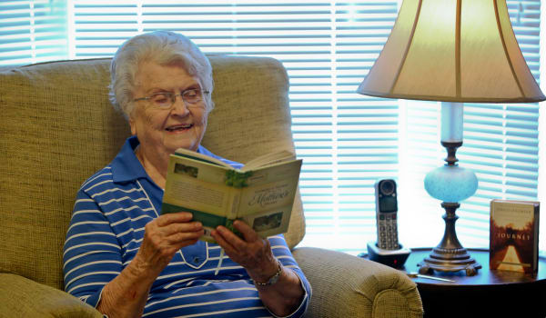 Senior woman reading a book Azalea Estates of Gonzales in Gonzales, LA