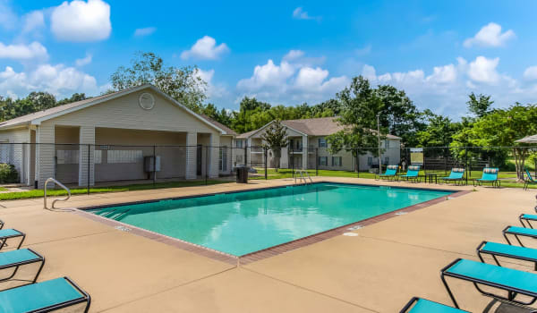 Sunglasses and a drink by the pool at Park Wind Apartments in Jackson, Mississippi