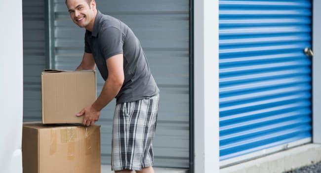 Man storing boxes at Storage Etc... Lakewood in Lakewood, Washington