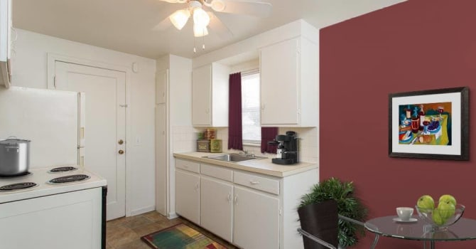 Bright kitchen with a ceiling fan at Park Place Townhomes in Buffalo, New York